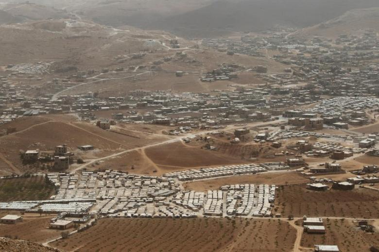 FILE PHOTO: A general view shows Syrian refugee camps dotted in and around the Lebanese town of Arsal, near the border with Syria, Lebanon September 21, 2016. REUTERS/Mohamed Azakir/File Photo