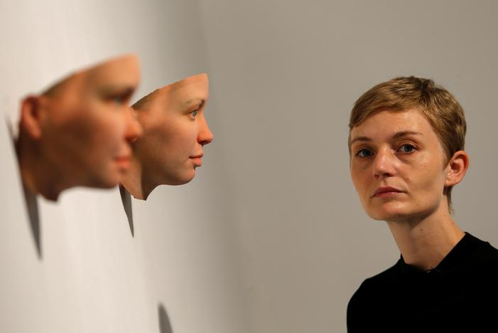 Artist Heather Dewey-Hagborg poses with 3-D printed masks created from DNA extracted from cheek swabs and hair clippings she received from formerly imprisoned U.S. Army Private Chelsea Manning while she was in jail, ahead of the August 2, 2017 opening of 'A Becoming Resemblance', an exhibition at the Fridman gallery in New York City, July 7, 2017. Mike Segar