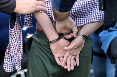 FILE PHOTO: U.S. Immigration and Customs Enforcement (ICE) arrest a man in...