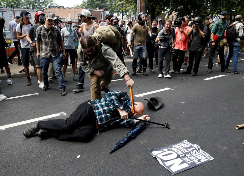 Counter demonstrators attack a white supremacist. REUTERS/Joshua Roberts