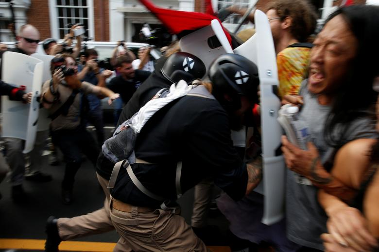 White nationalists clash with a group of counter-protesters. REUTERS/Joshua Roberts