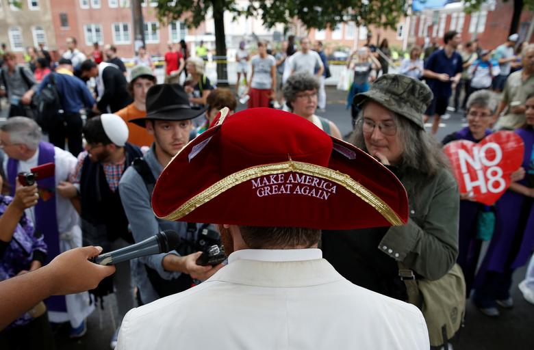 A white nationalist speaks to the media during a rally. REUTERS/Joshua Roberts