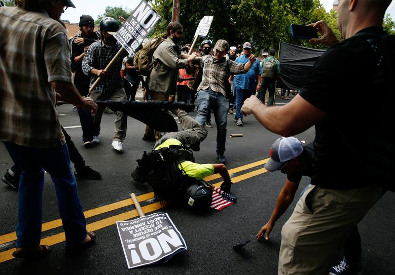 A man hits the pavement during a clash between white nationalist protesters against a group of counter-protesters. REUTERS/Joshua Roberts