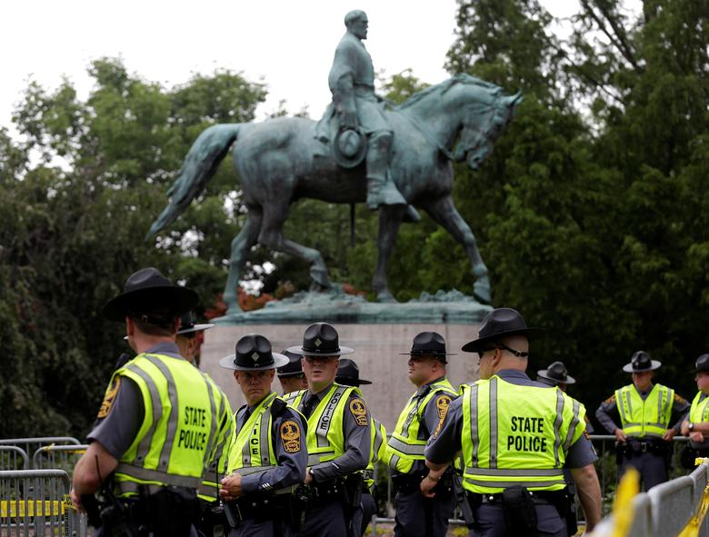 Virginia State Troopers stand under a statue of Robert E. Lee before a white nationalist rally. REUTERS/Joshua Roberts