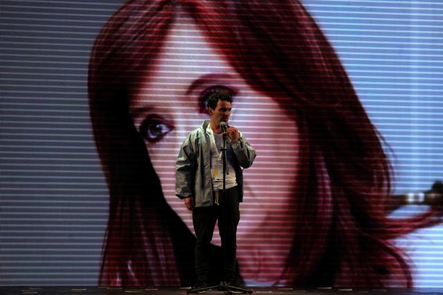 A man tests a microphone in front of a large screen with an image of Cristina Fernandez de Kirchner, former Argentine president and candidate for the Senate in the mid-term primary elections, at her campaign headquarters in Buenos Aires, Argentina August 13, 2017.  REUTERS/Marcos Brindicci