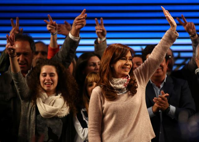 Cristina Fernandez de Kirchner, former Argentine President and candidate for the Senate in the mid-term primary elections, gestures to supporters at her campaign headquarters in Buenos Aires, Argentina August 14, 2017. REUTERS/Marcos Brindicci