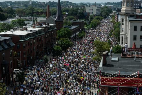 Thousands march against hate speech in Boston