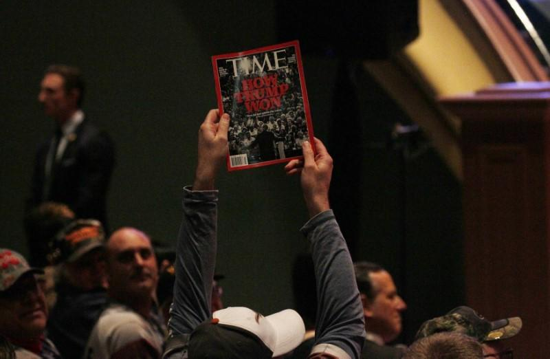 : A man holds up a copy of Time Magazine in Des Moines, Iowa January 28, 2016. Rick Wilking