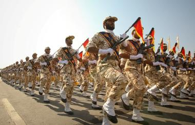 FILE PHOTO: Members of the Iranian revolutionary guard march during a...