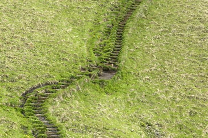 A staircase cut into the grass rises up a hillside in Skogarfoss, Iceland May 28, 2011. Lucas Jackson