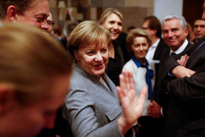 Merkel gets strong backing from her party after talks fail
