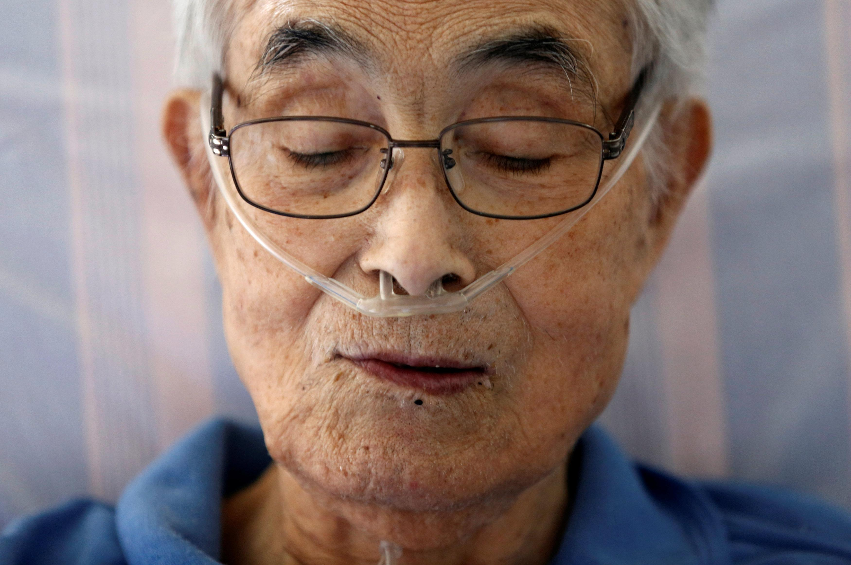 Katsuo Saito, 89, who has leukaemia, uses an oxygen tube as he rests at his house in Tokyo, Japan, September 8, 2017. Kim Kyung-Hoon