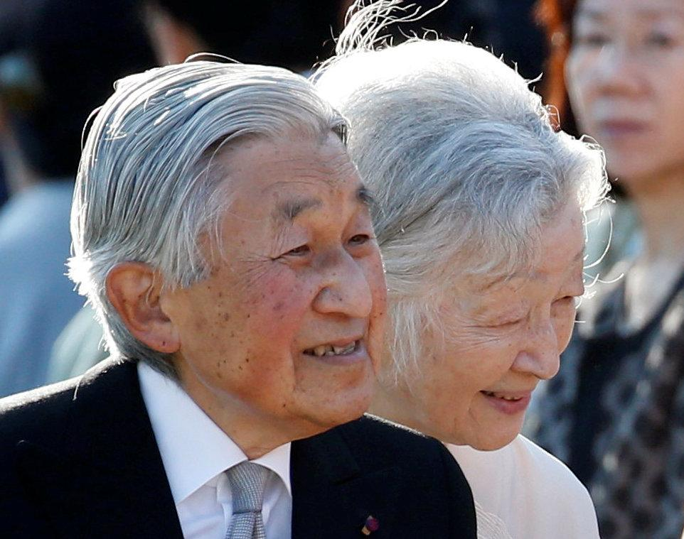 Japan's Emperor Akihito (L), flanked by Empress Michiko, greets guests during the annual autumn garden party at the Akasaka Palace imperial garden in Tokyo, Japan, November 9, 2017.  Toru Hanai