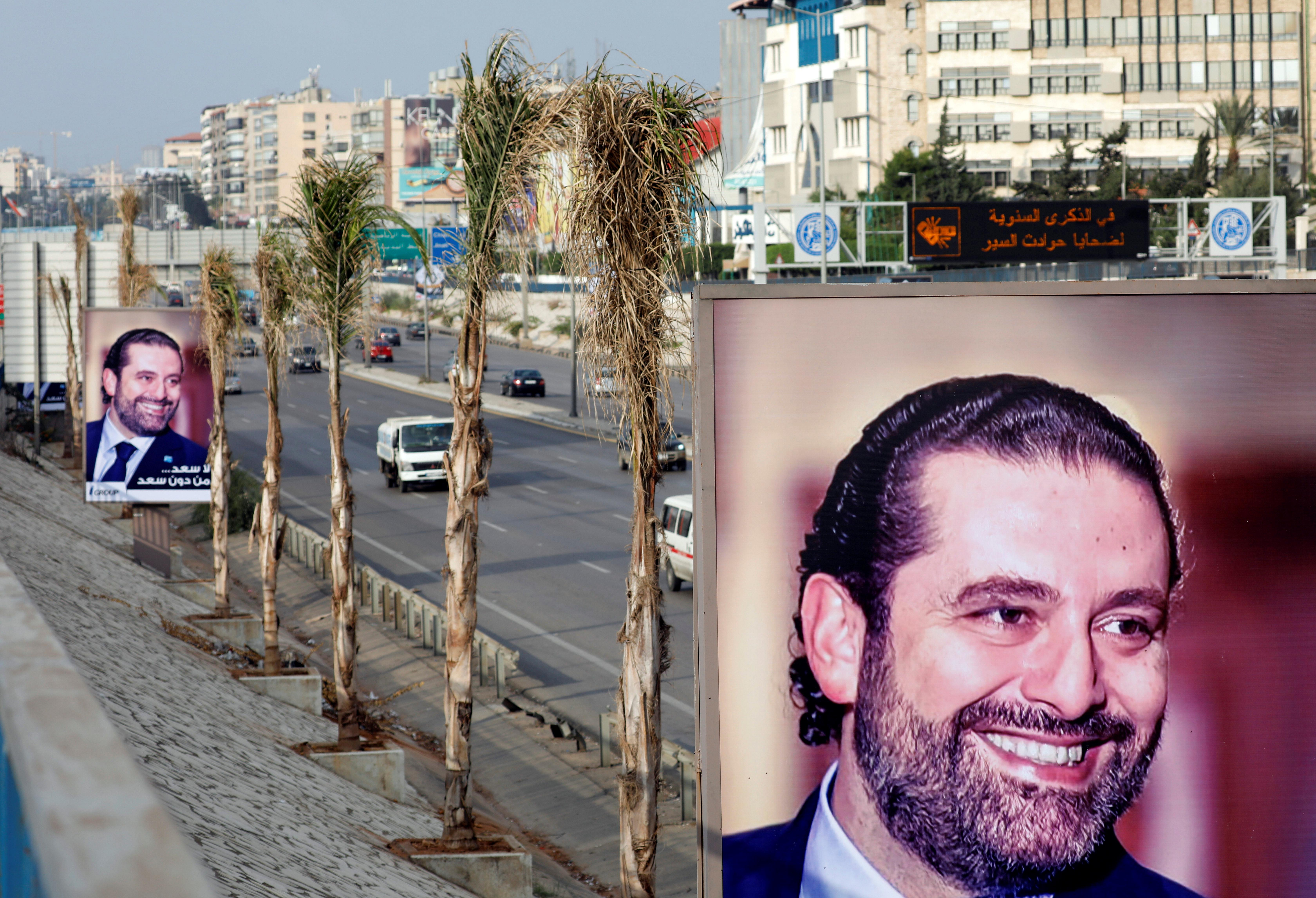 Posters showing Saad al-Hariri are displayed on the airport highway in the Lebanese capital of Beirut,. Hariri returned to Lebanon for Independence Day celebrations after announcing his resignation as prime minister while on a trip to Saudi Arabia. Jamal Saidi