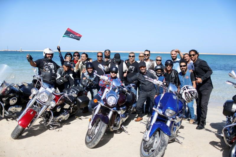 Members of the Tripoli bikers group pose for the camera at beach in Tripoli, Libya November 4, 2017. Picture taken November 4, 2017. Ahmed Jadallah