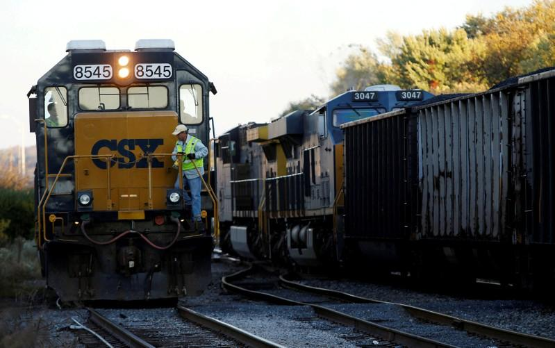 A CSX coal train (R) moves past an idling CSX engine at the switchyard in Brunswick, Maryland October 16, 2012. Gary Cameron