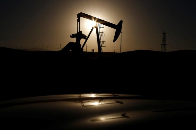 A pump jack is seen at sunrise near Bakersfield, California October 14, 2014.   Lucy Nicholson