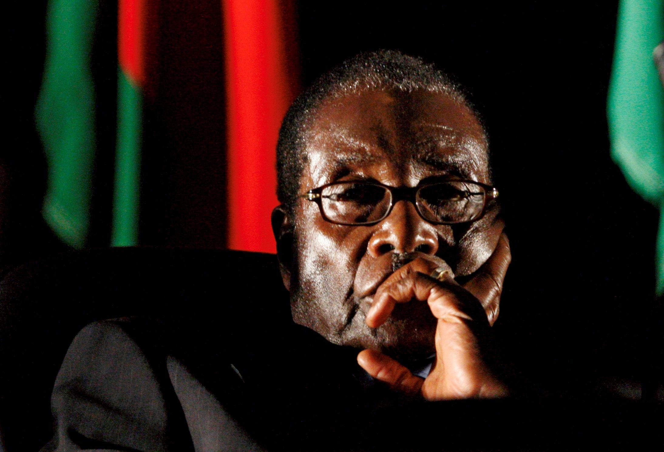 Zimbabwean President Robert Mugabe watches a video presentation during the summit of the Southern African Development Community (SADC) in Johannesburg, South Africa August 17, 2008. Mike Hutchings