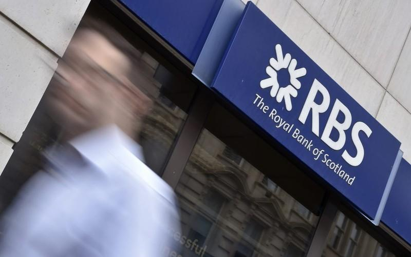 A man walks past a branch of The Royal Bank of Scotland (RBS) in central London August 27, 2014