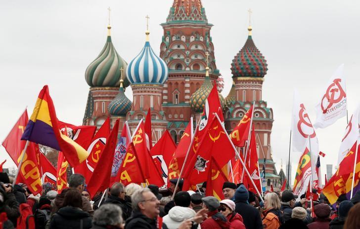Western leaders are increasingly concerned about Russian attempts to interfere in European and U.S. politics. Here, Russian Communist Party supporters carry flags at Red Square to mark the October Revolution's centenary in Moscow, November 5, 2017. Grigory Dukor