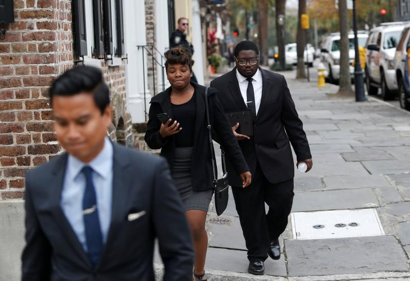 Walter Scott's son Miles Scott (R) leaves the Charleston federal court building after testifying during the 3rd day of the sentencing hearing for former North Charleston policeman Michael Slager in Charleston, South Carolina, U.S., December 6, 2017. Randall Hill