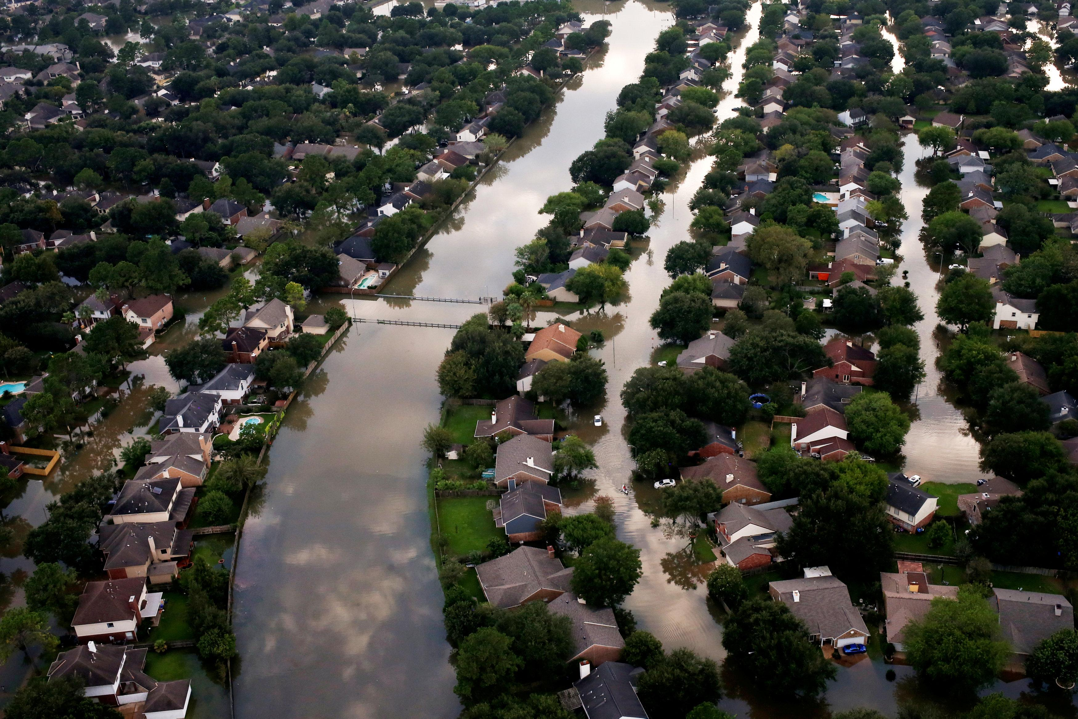 Houses are seen partially submerged in flood waters caused by Tropical Storm Harvey in Northwest Houston, Texas, U.S., August 30, 2017.Adrees Latif