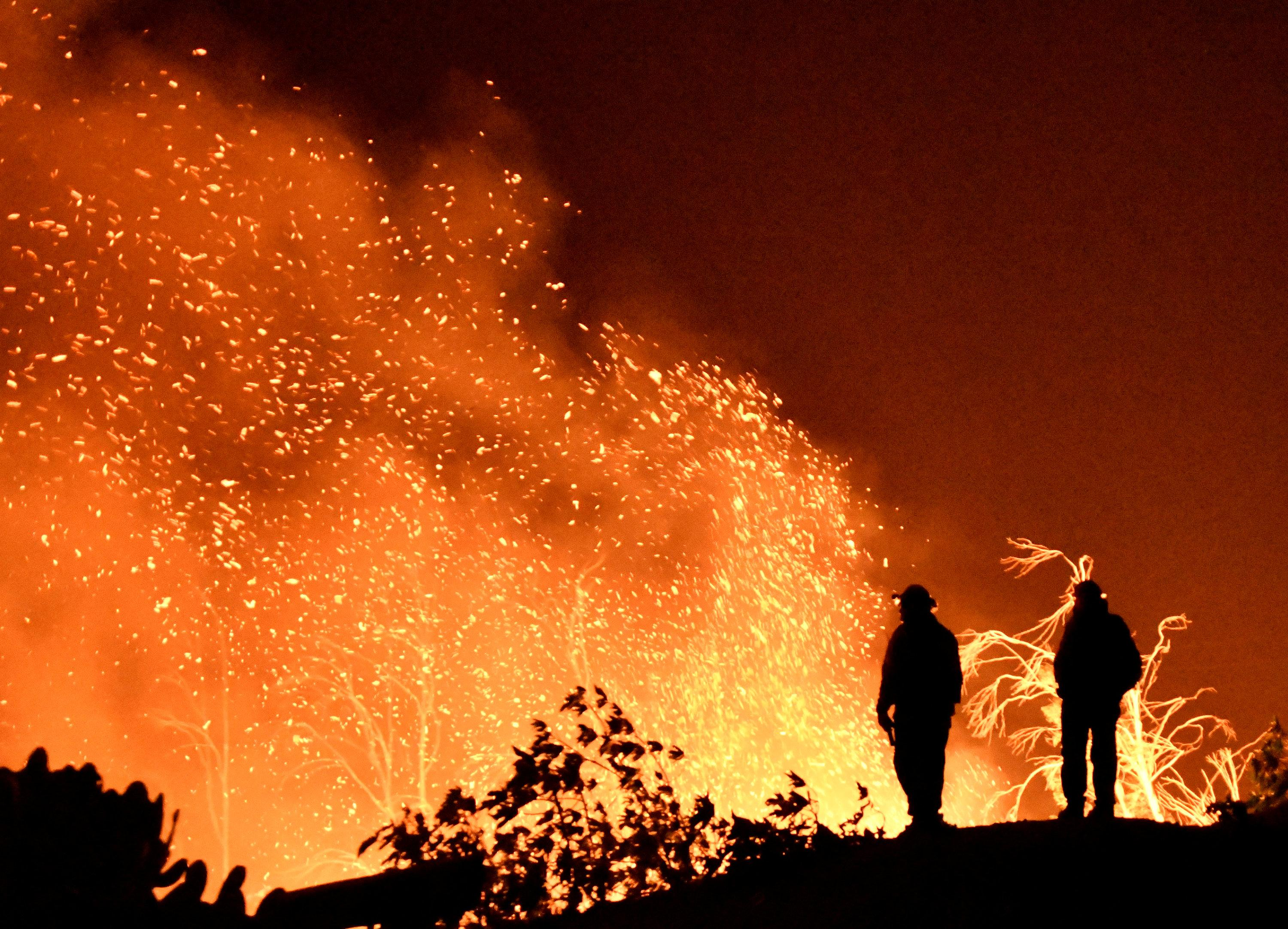 Firefighters keep watch on the Thomas wildfire in the hills and canyons outside Montecito, California, U.S., December 16, 2017. Gene Blevins