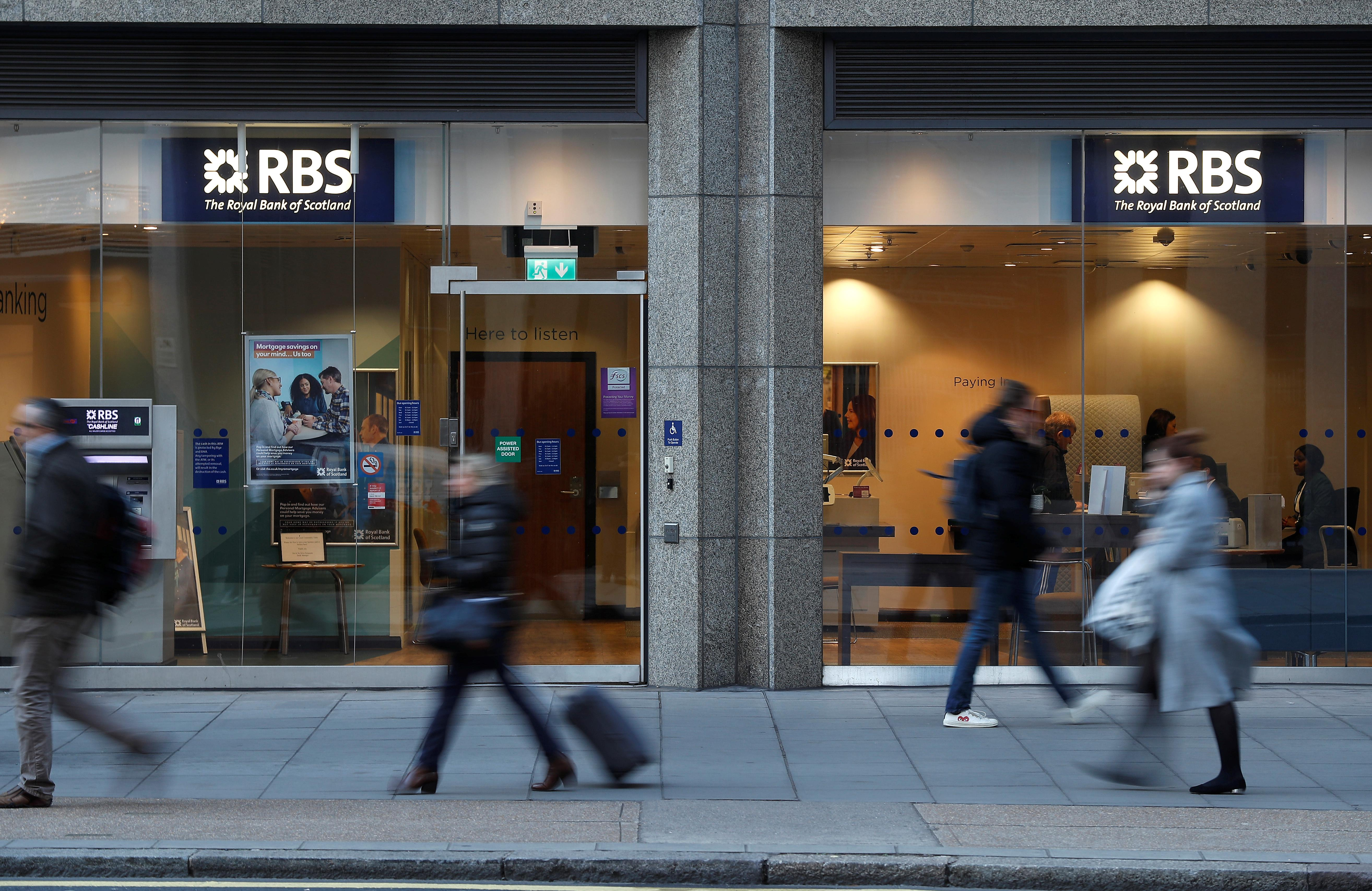 People walk past a branch of the Royal Bank of Scotland in London, Britain December 1, 2017.  Peter Nicholls