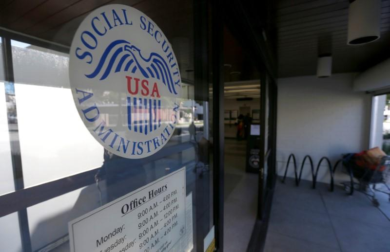 The entrance and logo of a Social Security Office in Pasadena, California U.S., March 14, 2017.   Mario Anzuoni