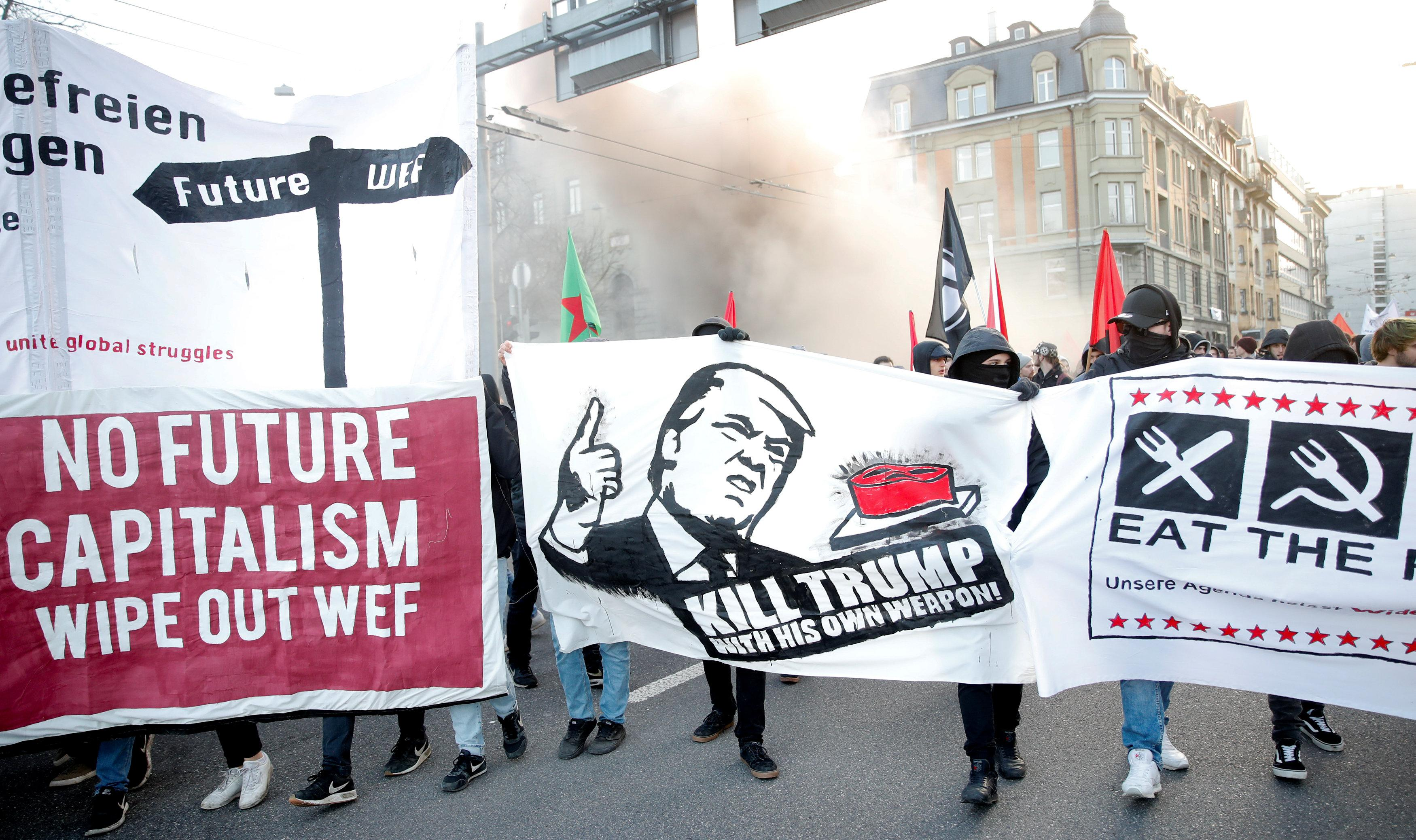 Merkels conservatives spd agree on german coalition blueprint anti trump demonstrators march in swiss capital malvernweather Image collections