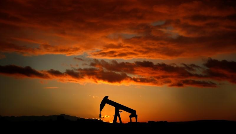 An oil pump jack is seen at sunset in a field outside Scheibenhard, near Strasbourg, France, October 6, 2017.   Christian Hartmann