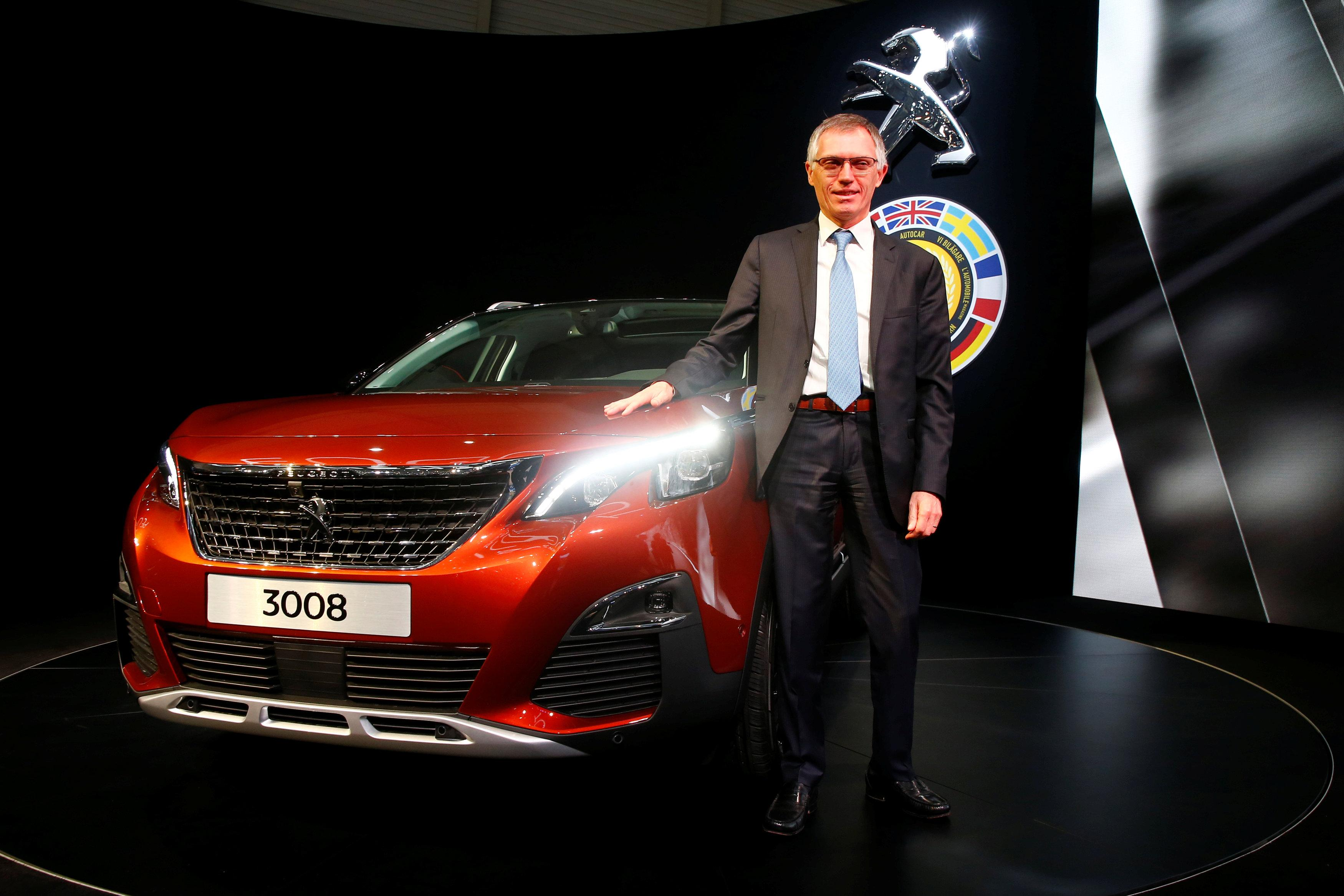 Carlos Tavares, CEO of PSA Peugeot Citroen, poses with the Car of the Year Peugeot 3008 during the 87th International Motor Show at Palexpo in Geneva, Switzerland, March 7, 2017. Arnd Wiegmann