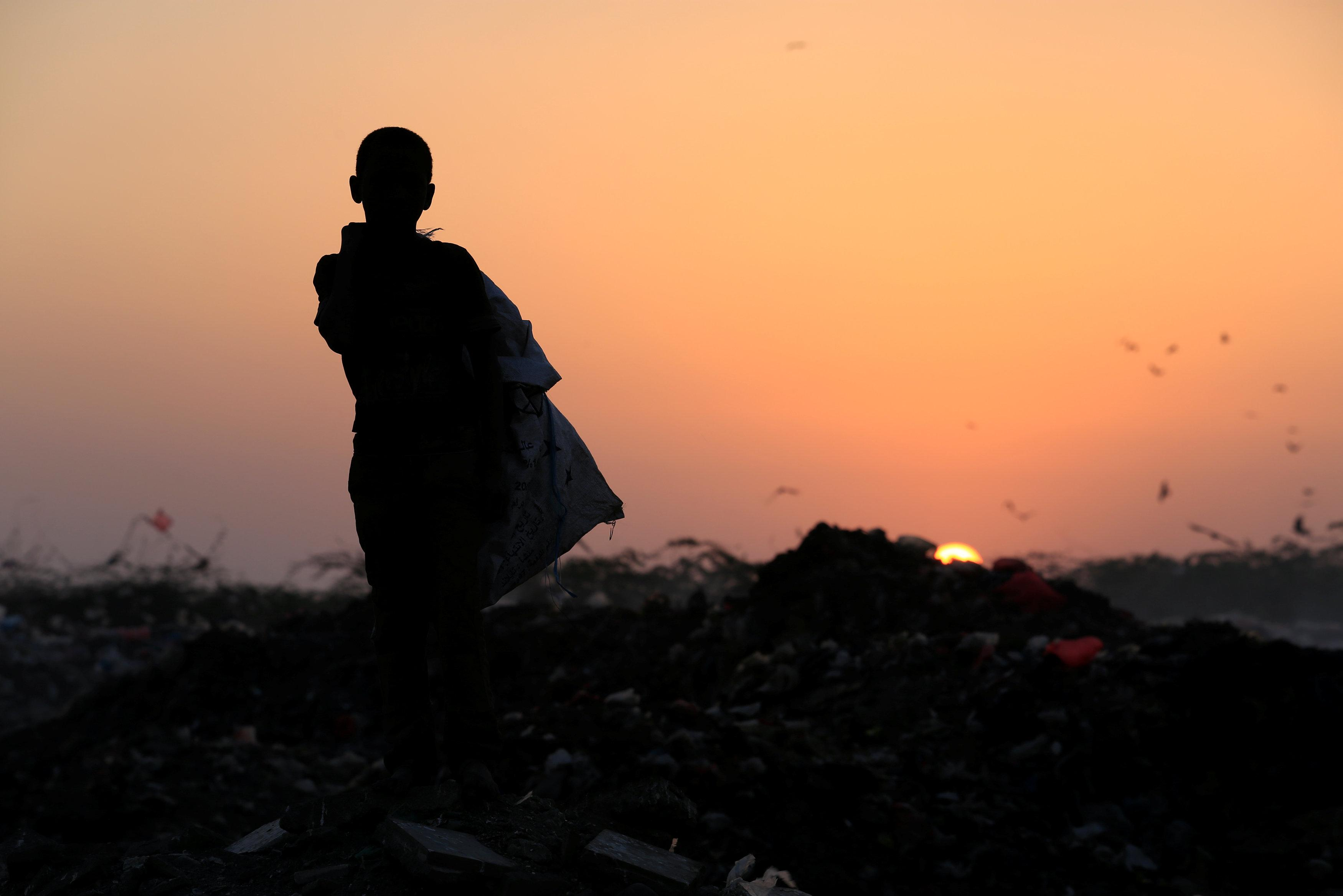 Ayoub Mohammed Ruzaiq, 11, stands in a garbage dump where he collects recyclables and food near the Red Sea port city of Hodeidah, Yemen, January 13, 2018.  Abduljabbar Zeyad
