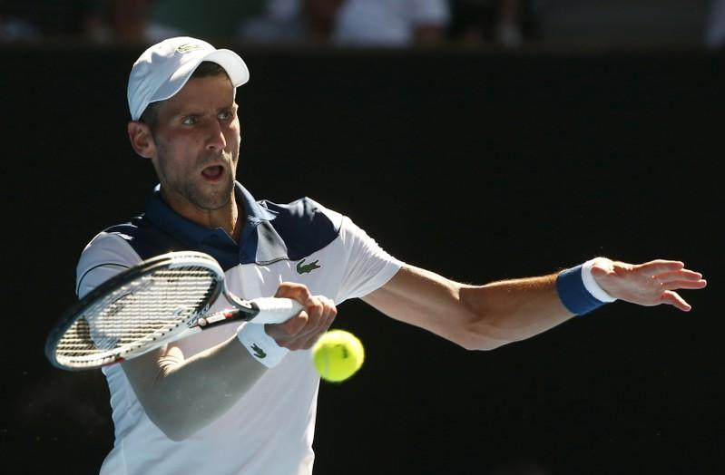 Tennis - Australian Open - Rod Laver Arena, Melbourne, Australia, January 18, 2018. Novak Djokovic of Serbia hits a shot against Gael Monfils of France. Thomas Peter