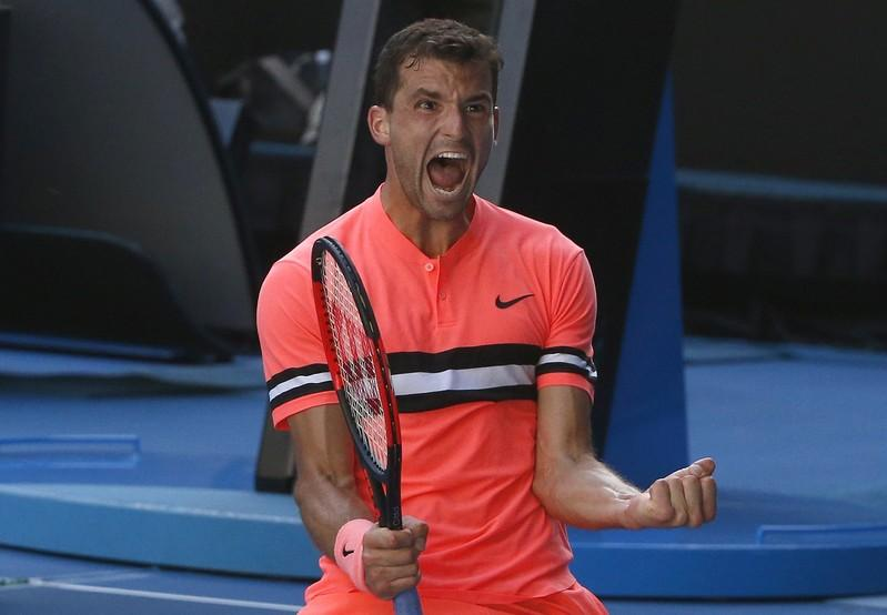 Tennis - Australian Open - Rod Laver Arena, Melbourne, Australia, January 19, 2018. Grigor Dimitrov of Bulgaria celebrates winning against Andrey Rublev of Russia. Thomas Peter