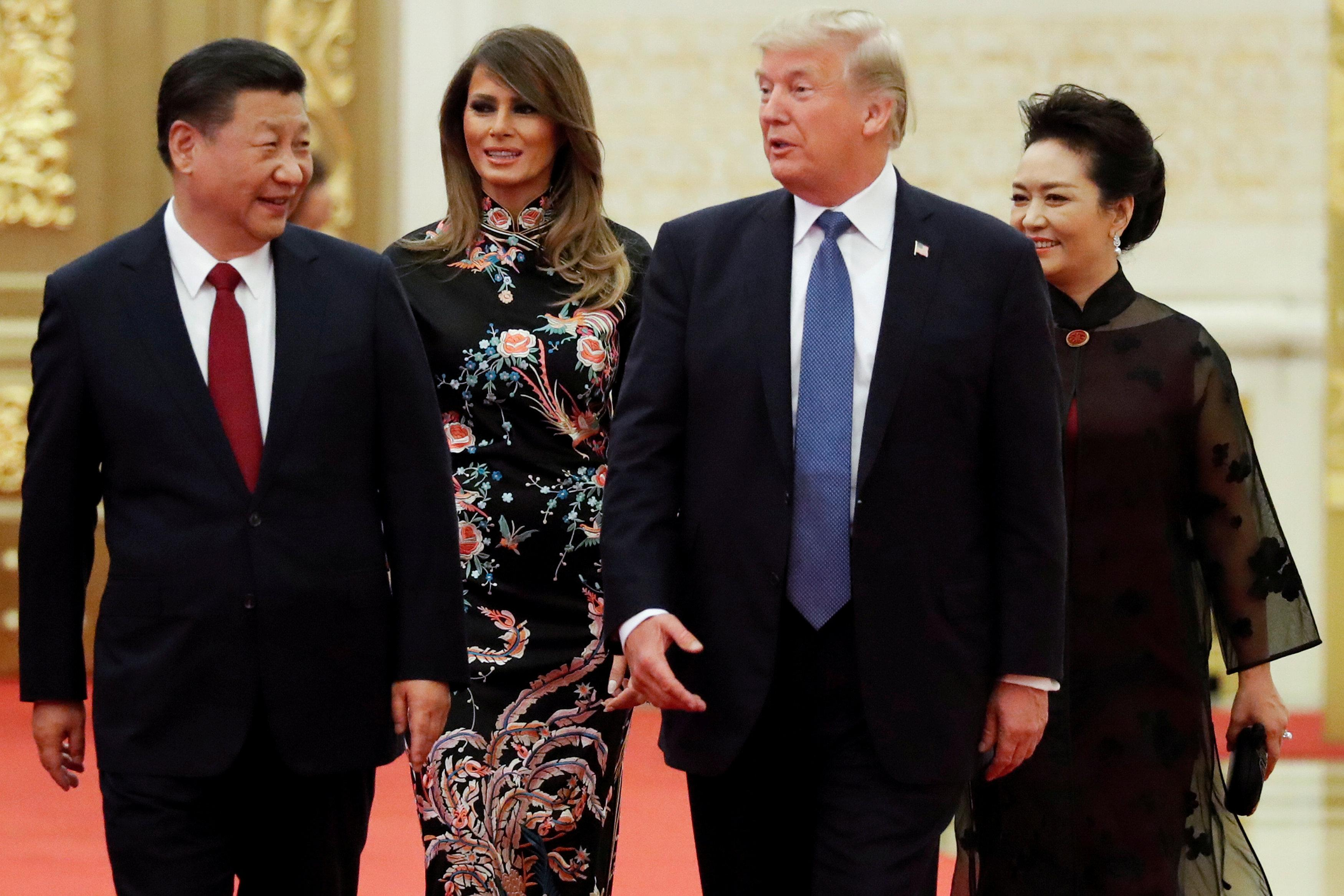 U.S. President Donald Trump and first lady Melania arrive for the state dinner with China's President Xi Jinping and China's first lady Peng Liyuan at the Great Hall of the People in Beijing, China, November 9, 2017. Jonathan Ernst