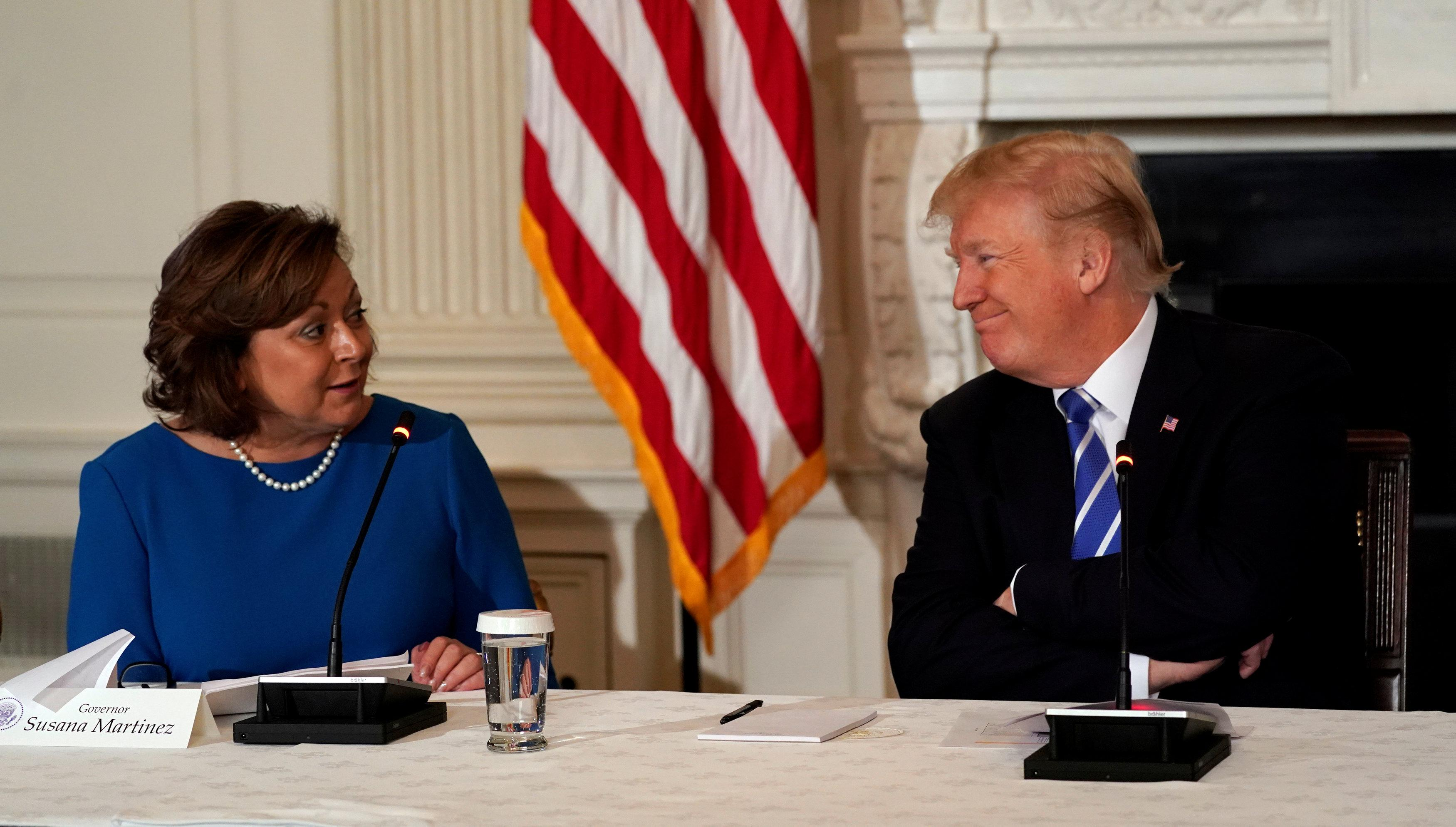 U.S. President Donald Trump looks toward New Mexico Governor Susana Martinez during a meeting on infrastructure at the White House in Washington, U.S., February 12, 2018. Kevin Lamarque