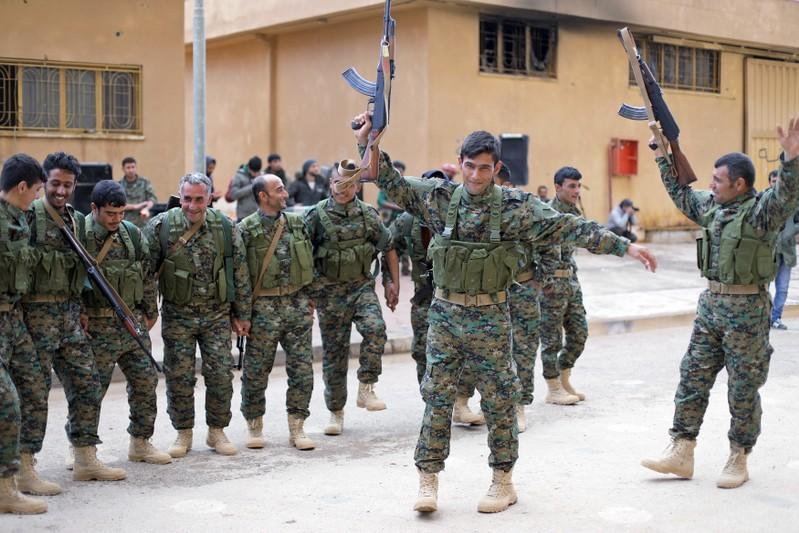 Fighters from a new border security force under the command of the Kurdish-led Syrian Democratic Forces in Hasaka, northeastern Syria, Jan. 20, 2018. Rodi Said