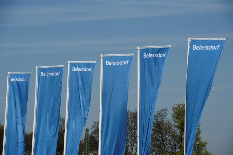 Flags of German personal-care company Beiersdorf are pictured at the annual shareholders meeting in Hamburg, Germany April 20, 2017. Fabian Bimmer