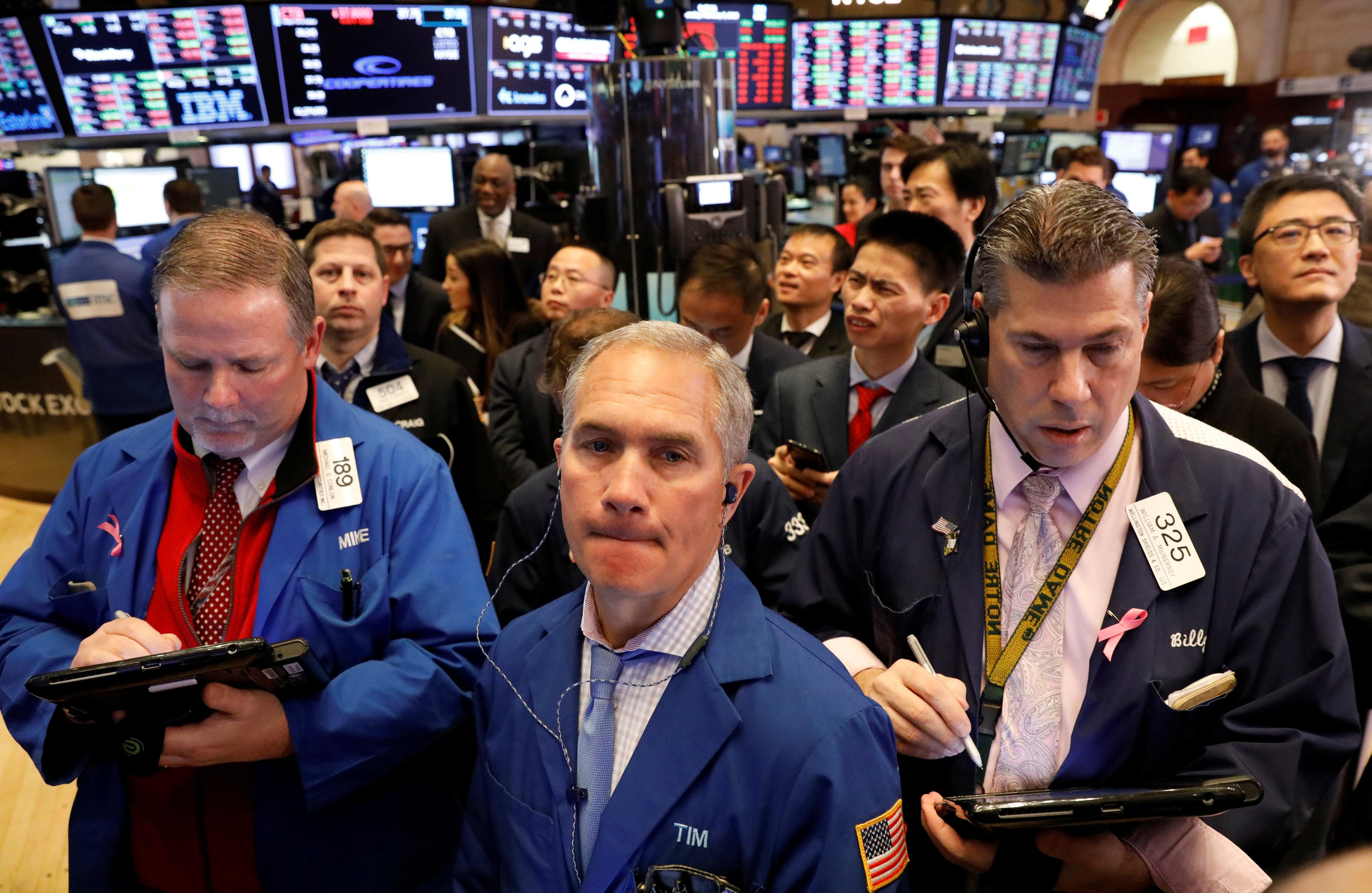 Traders work on the floor of the New York Stock Exchange (NYSE) in New York, U.S., February 8, 2018. Brendan McDermid