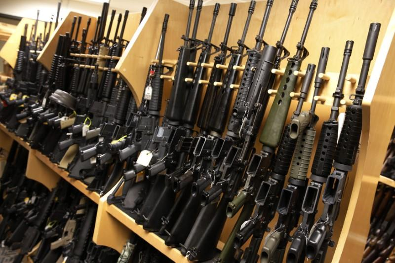 AR-15 rifles line a shelf in the gun library at the U.S. Bureau of Alcohol, Tobacco and Firearms National Tracing Center in Martinsburg, West Virginia December 15, 2015. The guns represent many of the models the ATF has come across in their investigations, and are collected through seizures from criminals or donations from manufacturers and members of the public.  Picture taken December 15, 2015.  Jonathan Ernst