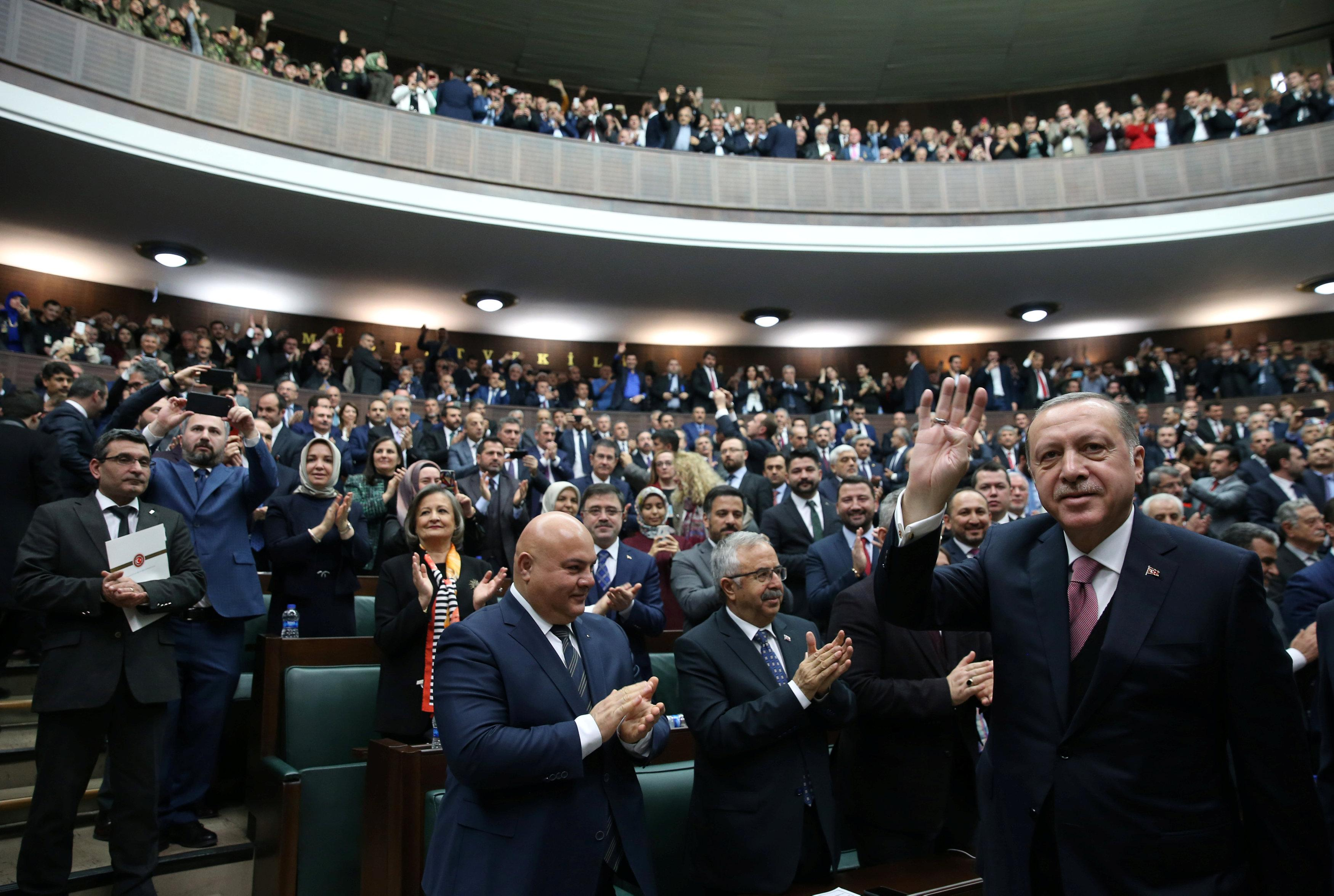 Turkish President Tayyip Erdogan greets members of parliament from his ruling AK Party (AKP) during a meeting at the Turkish parliament in Ankara, Turkey, February 20, 2018. Murat Cetinmuhurdar/Presidential Palace/Handout via