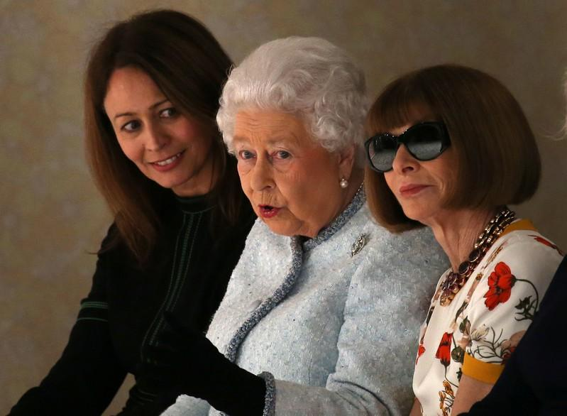 Caroline Rush (L), Chief Executive of the British Fashion Council, Britain's Queen Elizabeth II and Anna Wintour, Editor-in-Chief of Vogue attend the Richard Quinn show at London Fashion Week, in London, Britain February 20, 2018. Paul Hackett