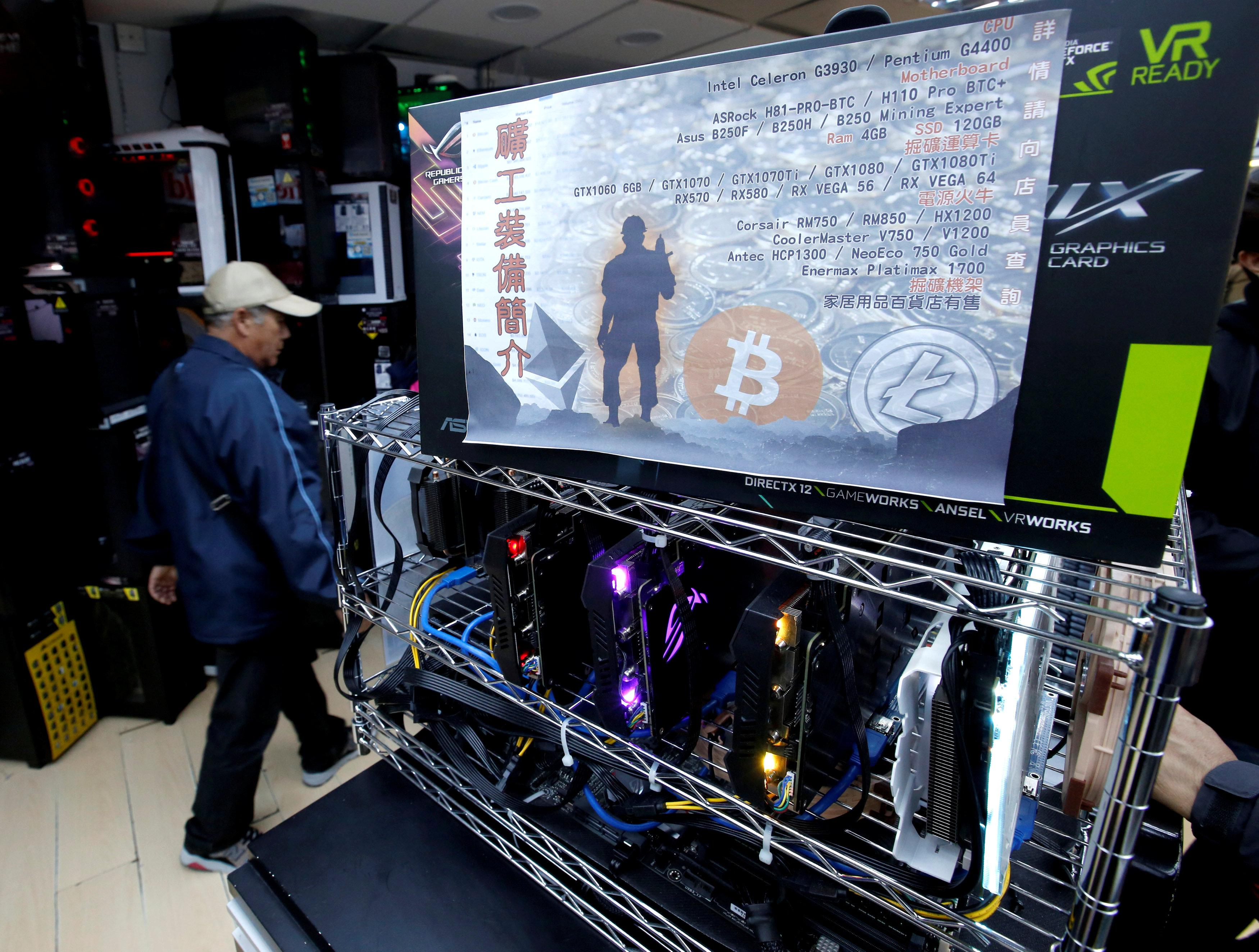 A cryptocurrency mining computer equipped with high-end graphic cards is seen on display at a computer mall in Hong Kong, China January 29, 2018. Picture taken January 29, 2018.  Bobby Yip