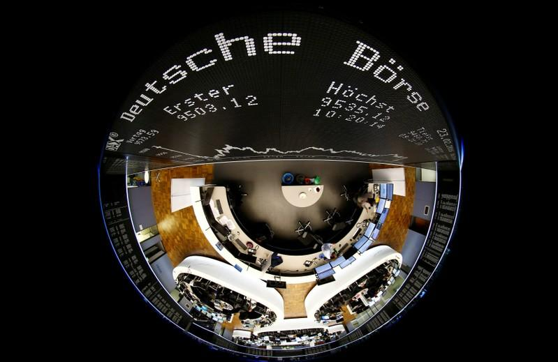 The German share prize index (DAX) board and the trading room of Frankfurt's stock exchange (Boerse Frankfurt) are photographed with a circular fisheye lens during afternoon trading session in Frankfurt, Germany, February 23, 2016. Kai Pfaffenbach