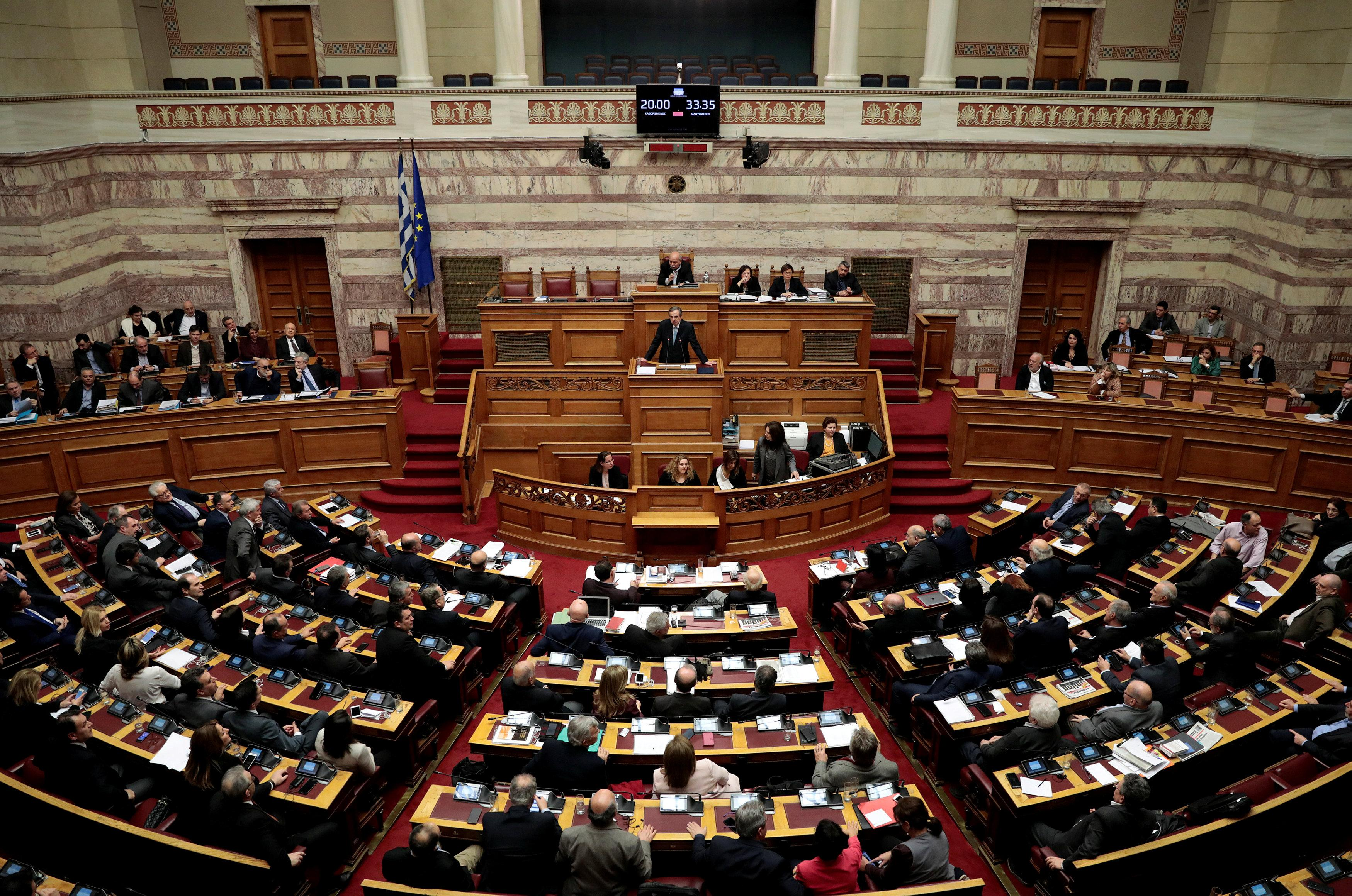 Former Greek Prime Minister Antonis Samaras addresses lawmakers during a parliamentary session before a vote on setting up a special committee which will probe the role of ten politicians in a case which involves alleged bribery by Swiss drugmaker Novartis, in Athens, Greece, February 21, 2018. Alkis Konstantinidis