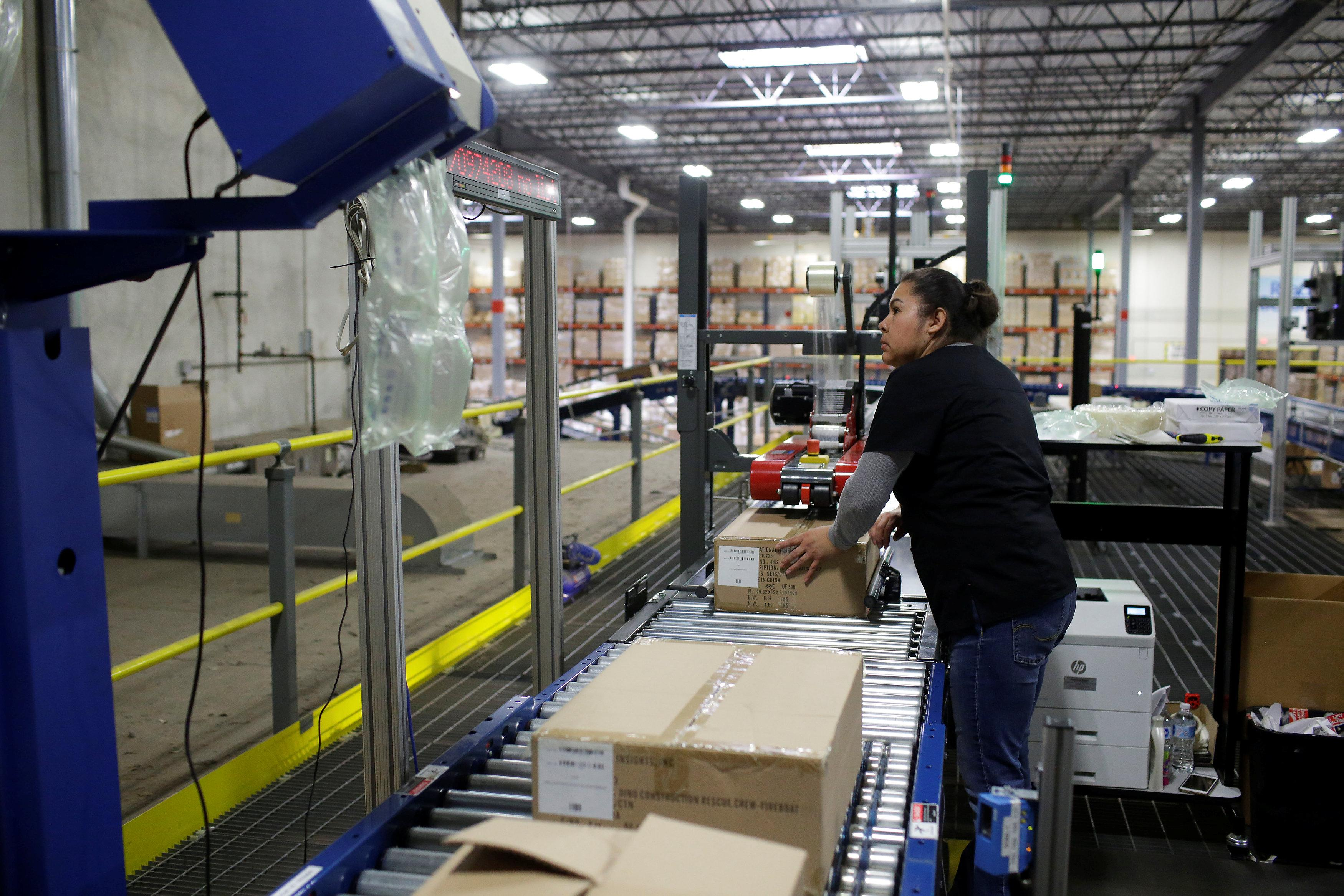 Exhausted toys r us suppliers weigh options as huge retailer toys r us vendor learning resources worker moves a box on a conveyor belt buycottarizona Images