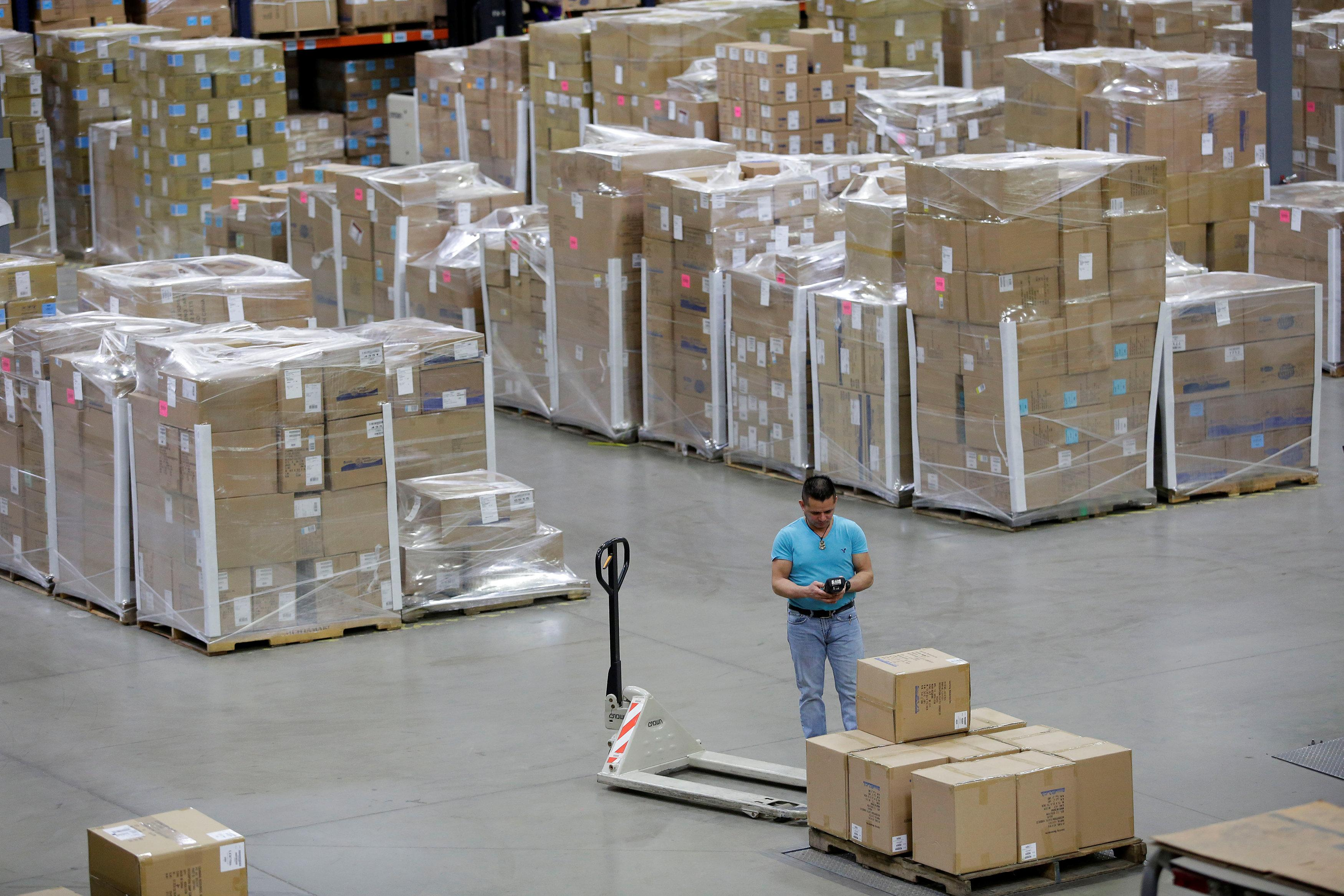 Exhausted toys r us suppliers weigh options as huge retailer toys r us vendor learning resources worker scans boxes on a pallet at the buycottarizona Images