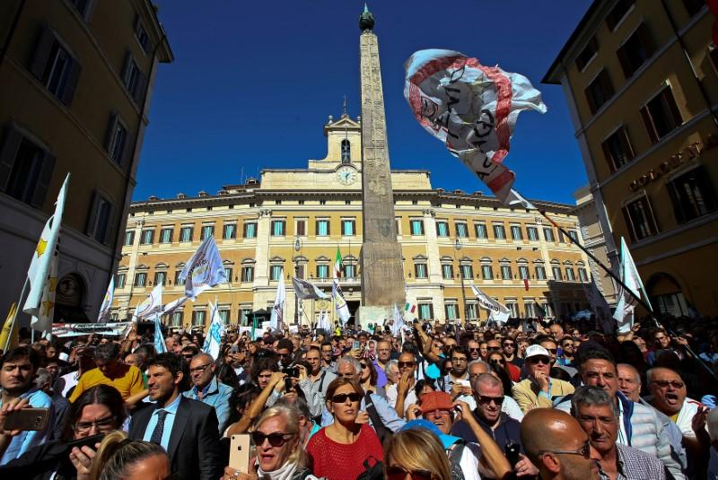 5-Star Movement supporters protest in front of the Palazzo Montecitorio, seat of the Italian Chamber of Deputies, in Rome. Beppe Grillo, the Movement