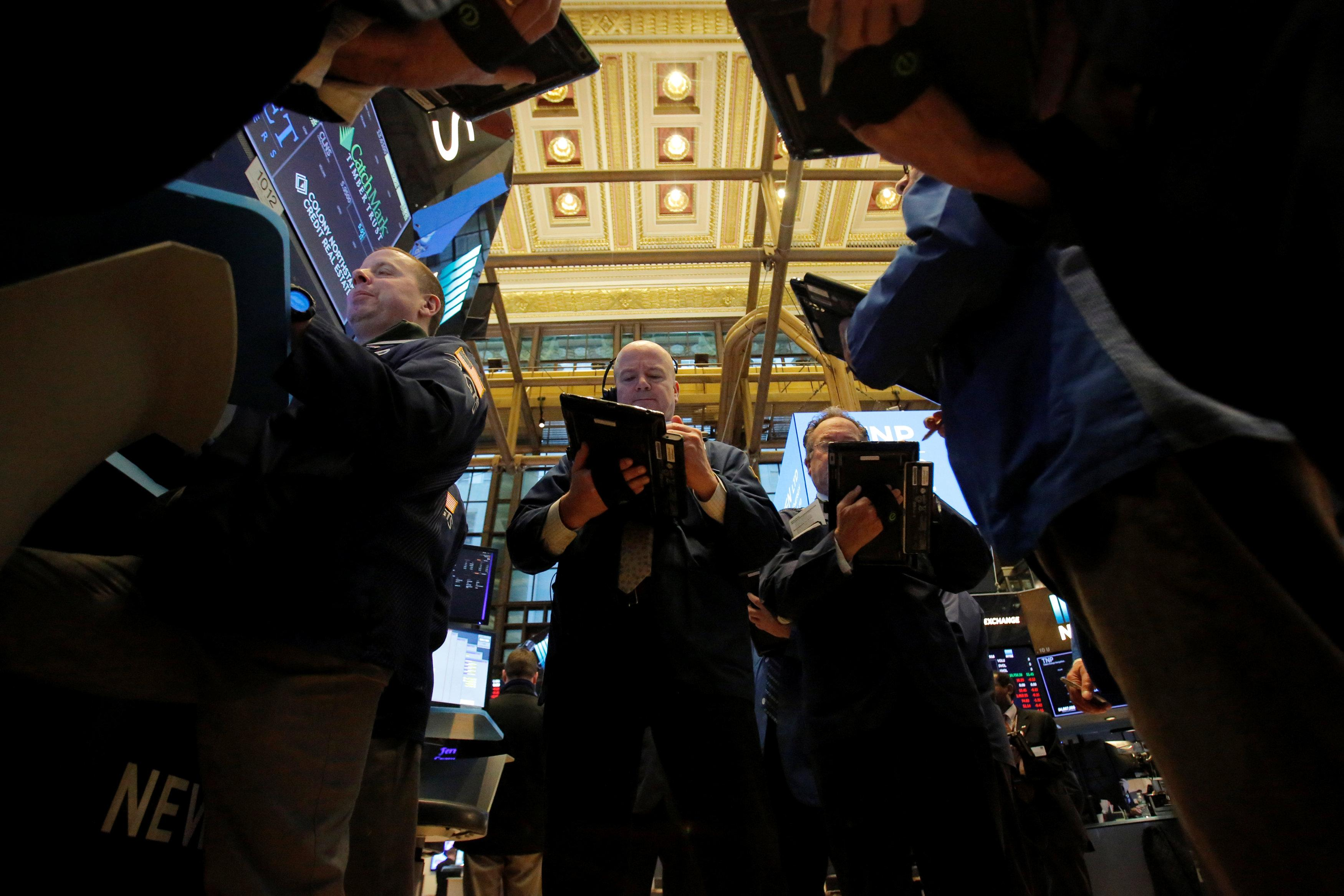 Traders work on the trading floor at the New York Stock Exchange (NYSE) in Manhattan, New York City, U.S., March 14, 2018. Andrew Kelly